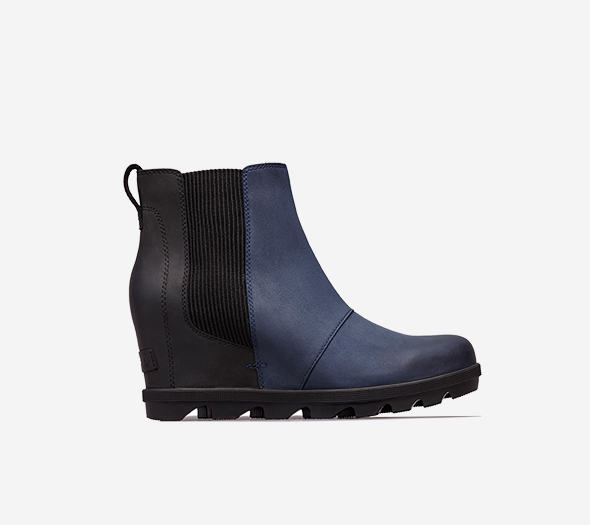 Profile view of a collegiate navy Joan Wedge Chelsea boot