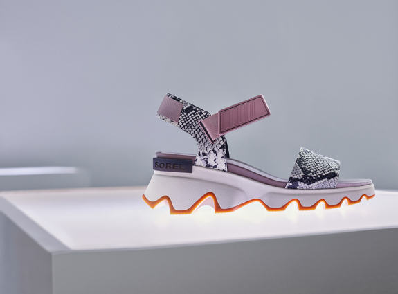 A Kinetic Impact sandal on a white background