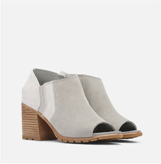A pair of SOREL Nadia ankle booties on a white background