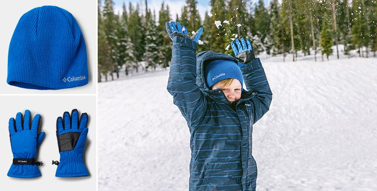 A child playing in the snow. Close-ups of the blue beanie and blue gloves he is wearing.