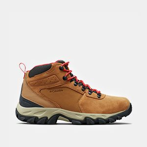A mens short tan hiking boot.