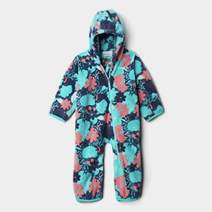 A fleece onesie with a fun blue and pink pattern.