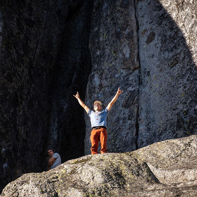 Climber doing the horns signal with his hands stoked to be at donner.