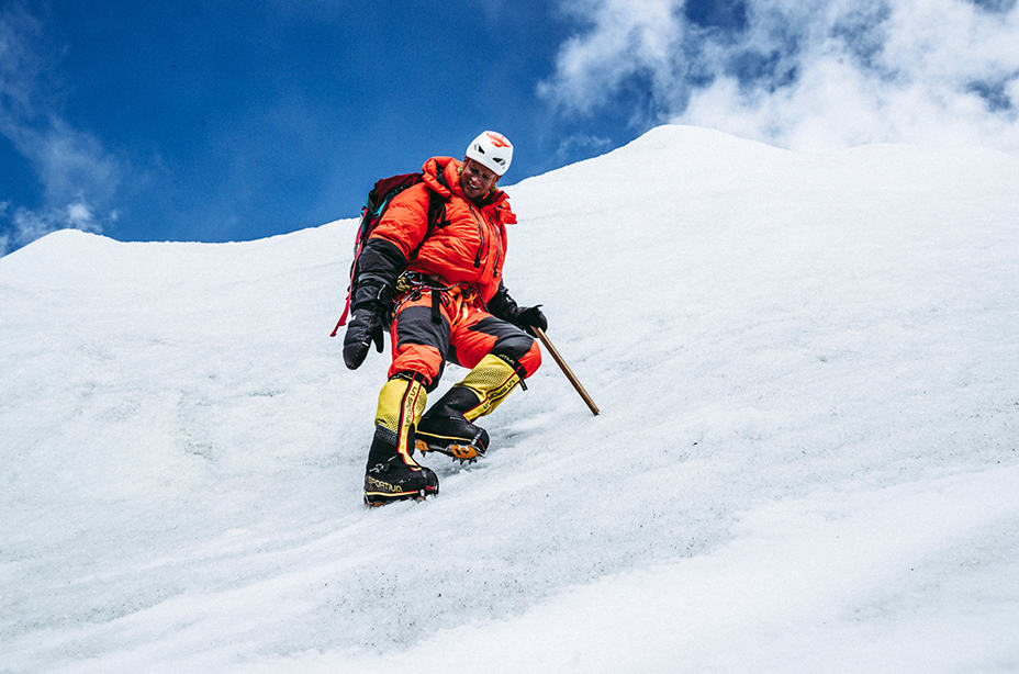 Garrett Madison product testing an Absolute Zero Suit, exploring glaciers at Everest Base Camp.