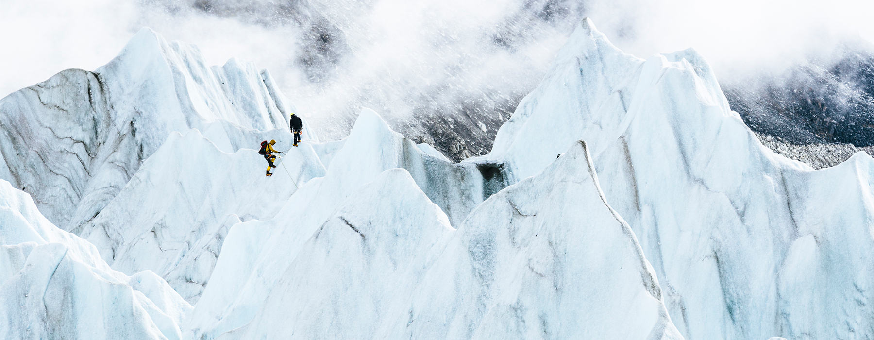 Image of Garrett Madison and Tim Emmett product testing future Absolute Zero Suits in the glacier fall near Everest Base Camp.