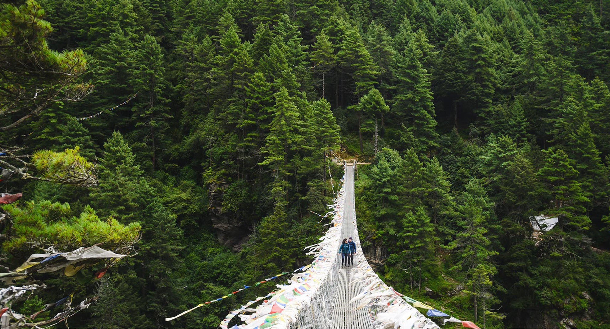Trekking over suspension bridge shot