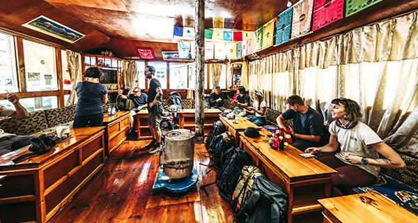 Mountain Hardwear crew takes a break from the Everest Base Camp trek in a tea house near Nimchi Valley, Nepal.