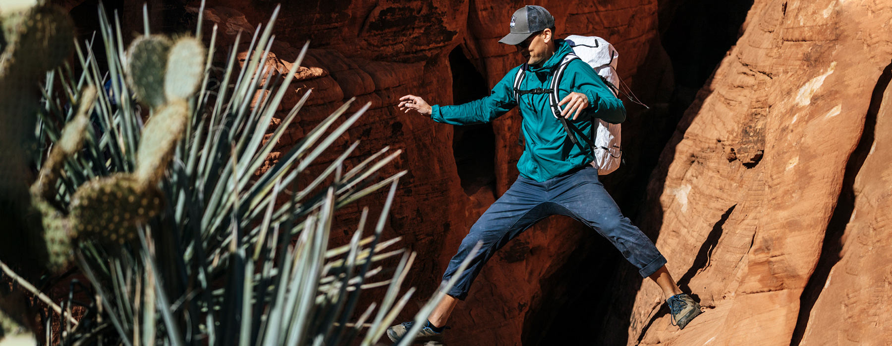 Men's Kor Preshell™ Hoody in action, climber straddling between rocks